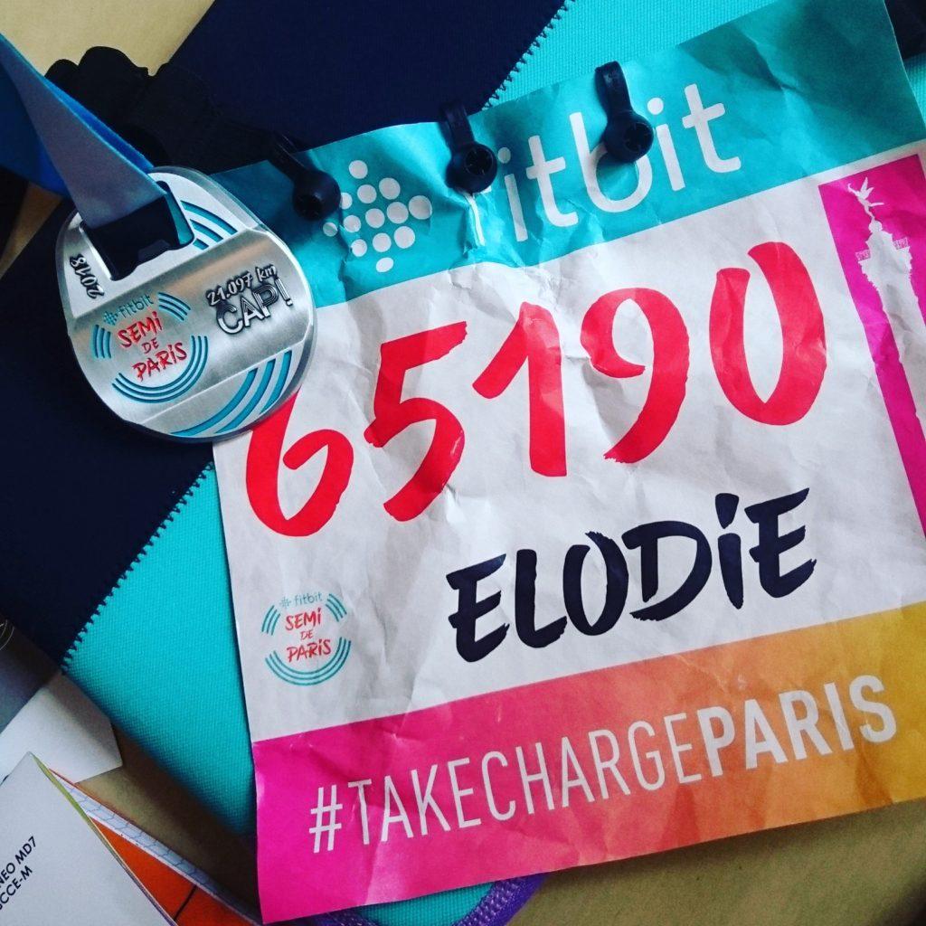 Médaille et dossard du Semi de Paris 2018